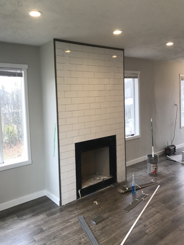 Riverton, UT - Putting the finishing touches on the fireplace. This Riverton property should be on the market next week.